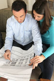Couple examining a blueprint — Stock Photo