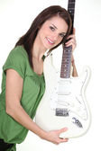 Pretty girl holding guitar — Stock Photo