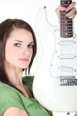Determined young woman holding an electric guitar — Stock Photo