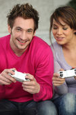 Young playing with console — Stock Photo