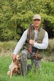 Hunter with dog — Stock Photo