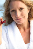 Woman with two cherries — Stock Photo