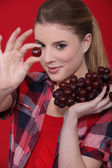 Young girl with bunches of grapes — Stock Photo
