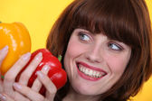 Woman with peppers — Stock Photo