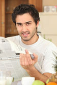 Man reading the daily newspaper — Stock Photo