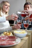 Friends having an informal dinner party — Stock Photo