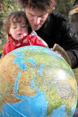 Father and son with a globe — Stock Photo