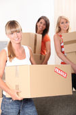 Girls charged with cardboard — Stock Photo