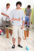 Young men doing chores — Stock Photo