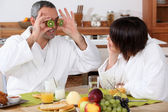 Couple having breakfast in bathrobe — Stockfoto