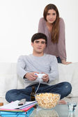 Man being distraction studies by video games — Stockfoto