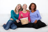 Friends watching a movie together — Stock Photo