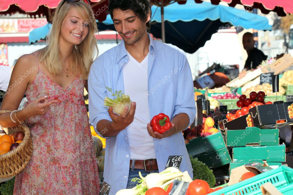 Couple buying vegetables  Stock Photo #9745853