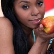 Gorgeous black woman eating apple — Stock Photo
