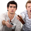 Stock Photo: Young men watching TV