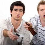 Young men watching TV — Stock Photo