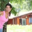 Stock Photo: Brunette womin front of chalet