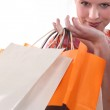 Blond woman holding shopping bags — Stock Photo