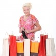 Excited blond woman going through her purchases — Stock Photo #9754721