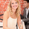 Woman in restaurant with a glass of champagne — Stock Photo #9754955