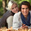 Stock Photo: Couple laid in woods