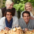 Two couples gathering mushrooms in the woods — Stock Photo #9755322