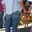Young couple at market buying fruits — Stock Photo #9756685