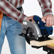 Stock Photo: Mason using circular saw