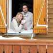Stock Photo: Couple staying in wooden chalet