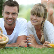 Stock Photo: Couple having romantic picnic in field
