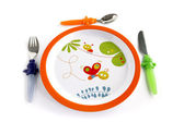 Colorful plate and cutlery for a child — Stock Photo