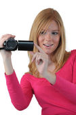 Woman holding compact video camera — Stock Photo