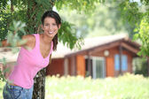 Brunette woman in front of chalet — Stock Photo