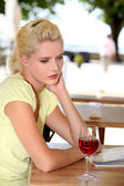 Woman on the terrace with a glass of wine — Stock Photo