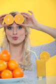 Woman with slices of orange on the forehead — Stock Photo