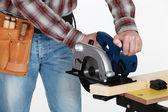 Mason using circular saw — Stock Photo