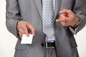 Man pointing at business card — Stock Photo
