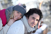 Portrait of a couple by wintertime — Stock Photo