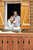Couple staying in wooden chalet — Stok fotoğraf