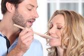 Man having her wife taste preparation — Stock Photo