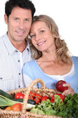 Couple with vegetable basket — Stock Photo