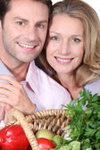 Wife puts arms around husband. — Stock Photo