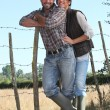 Stock Photo: Young couple of farmers