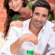 Couple with cocktail — Stock Photo