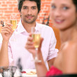 Couple in a restaurant with champagne — Stock Photo