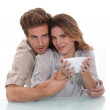 Couple with a bowl — Stock Photo #9765476