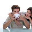 Couple with large bowl of coffee — Stock Photo #9765519