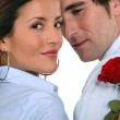Couple with a red rose — Stock Photo
