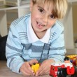 Little boy playing with toys — Stock Photo #9766220