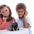 Children playing on the phone — Stock Photo #9766524